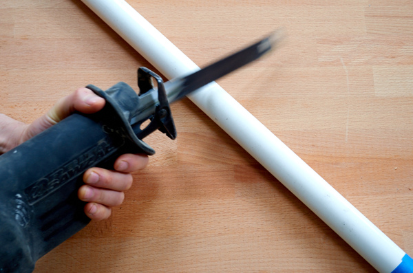 reciprocating saw cutting PVC pipe