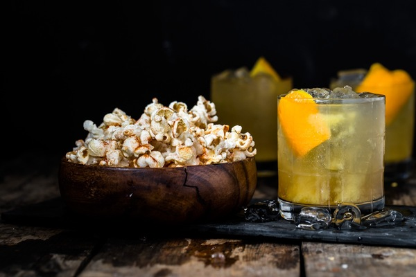 Orange tequila cocktail and chili-lime popcorn