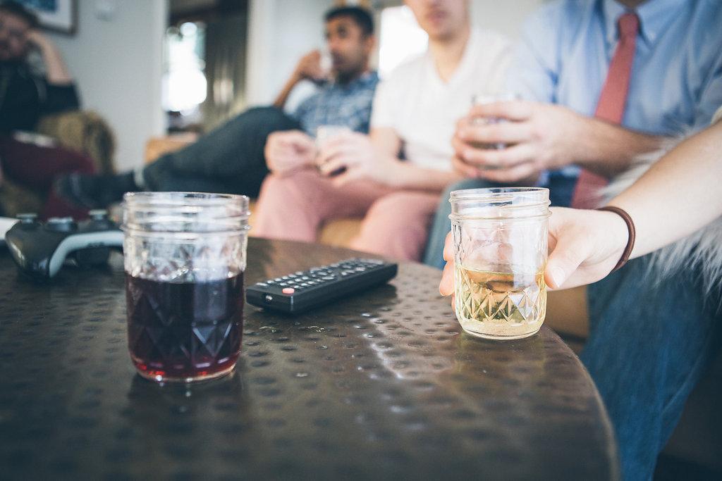 Friends chatting and enjoying wine