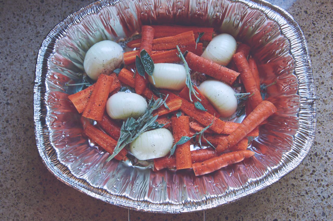 Bed of vegetables in a roasting pan