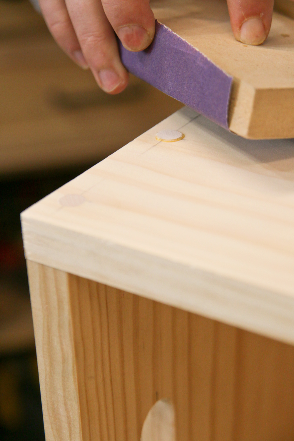 Sand the dowel rods down until they're flush