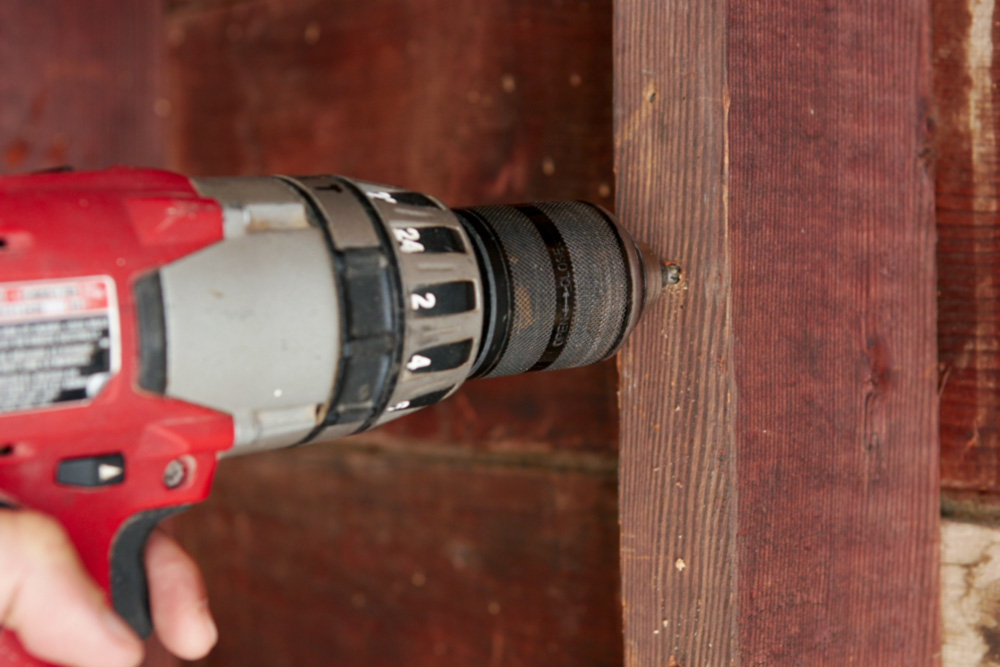 drilling a pilot hole for a screw hook