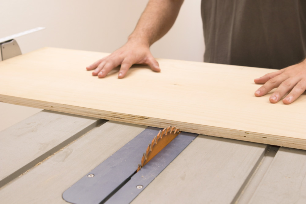 cutting the clamp rack on the table saw