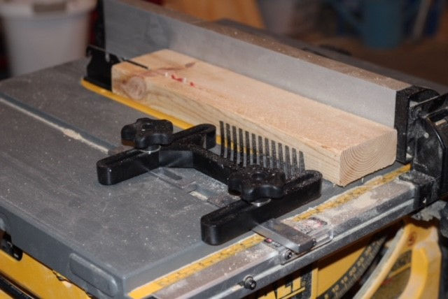 rip a 2x4 to 2.5 inches on the table saw.