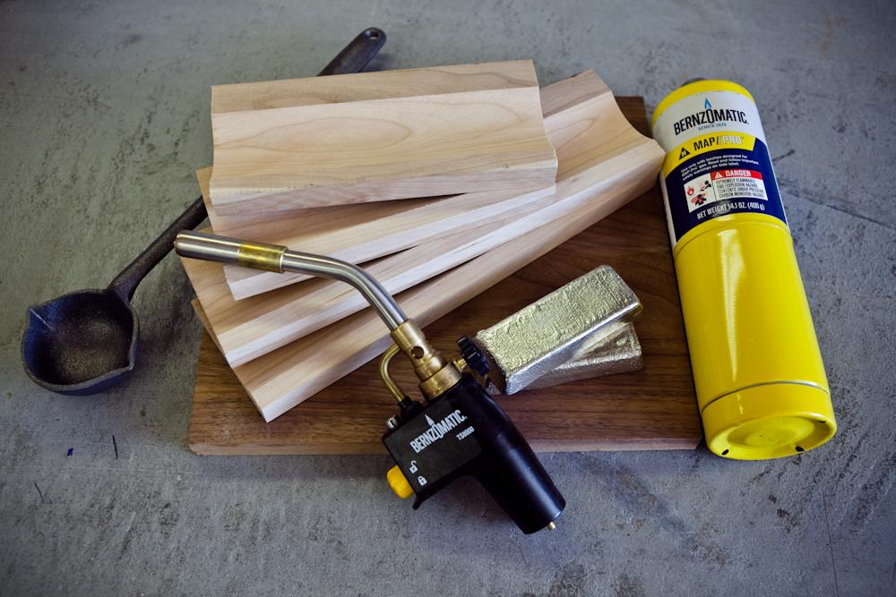 Blow torch, wood, and metal ingots
