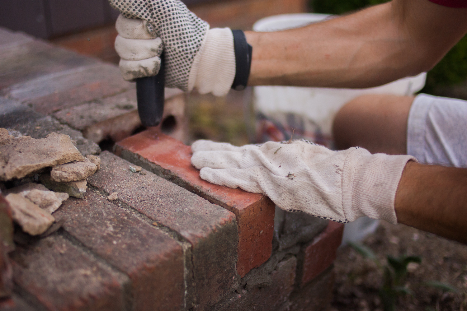 tapping down a newly installed brick