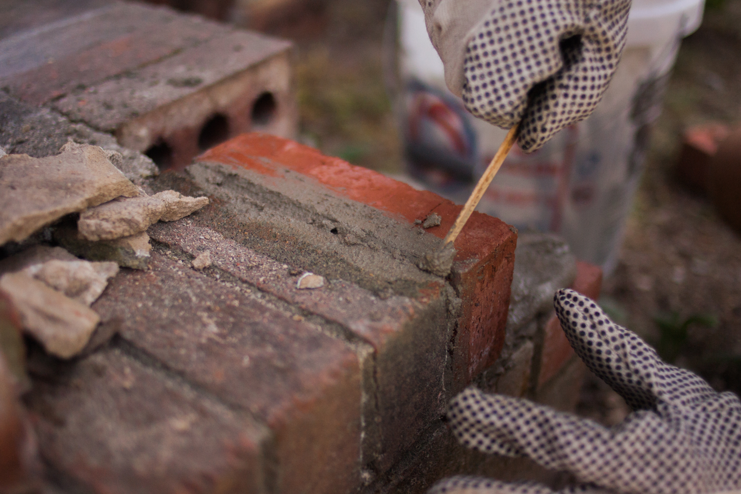 smoothing out excess mortar from bricks