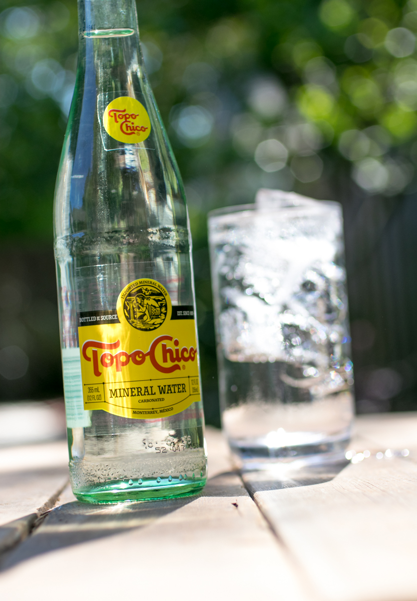 Topo Chico bottle sparkling water in outdoor setting