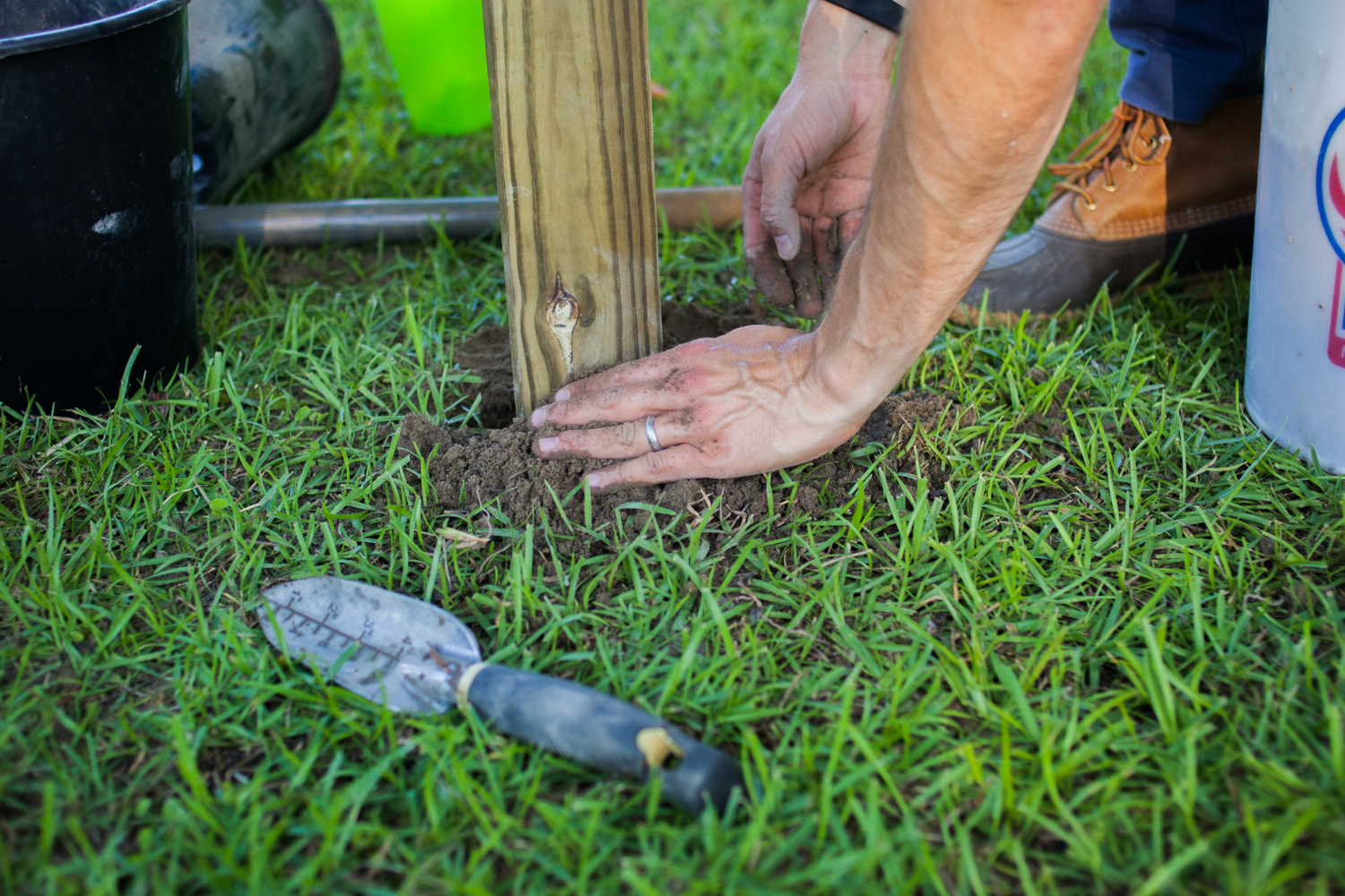 setting a clothesline post into the ground
