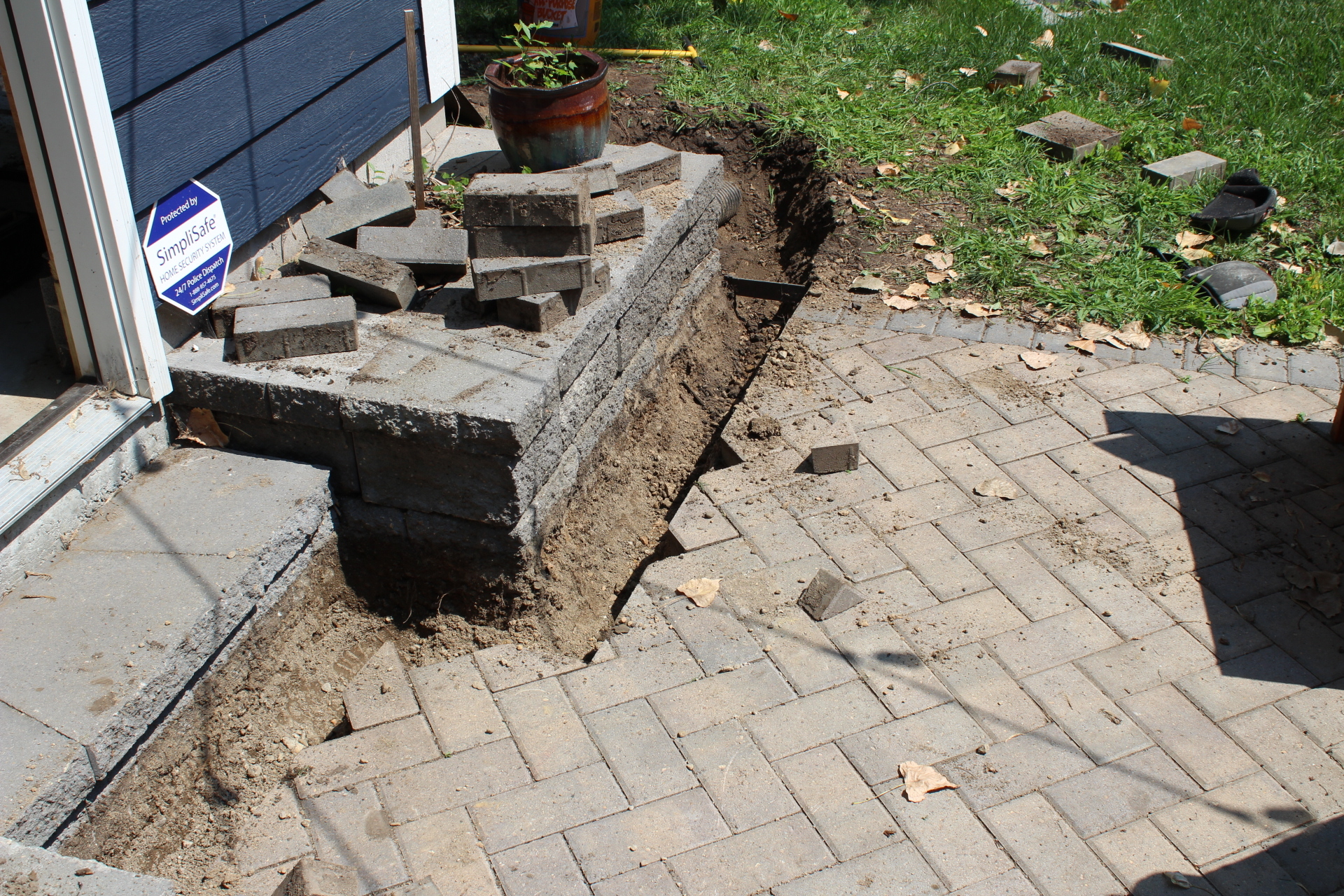 trench dug in front of a house to fit in channel drain