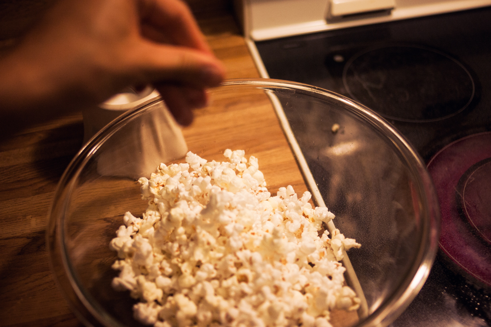 perfect stovetop popcorn - season each layer