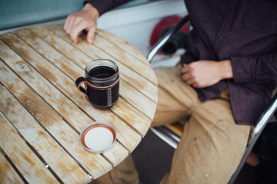 leather and glass coffee mug